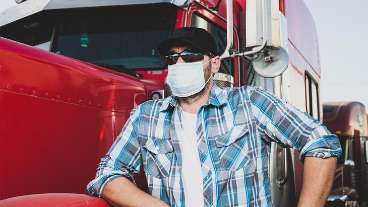 COVID-19 manufacturing heavy duty trucker with mask