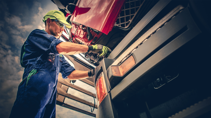 Preventive maintenance inspection engine cooling systems mechanic at truck