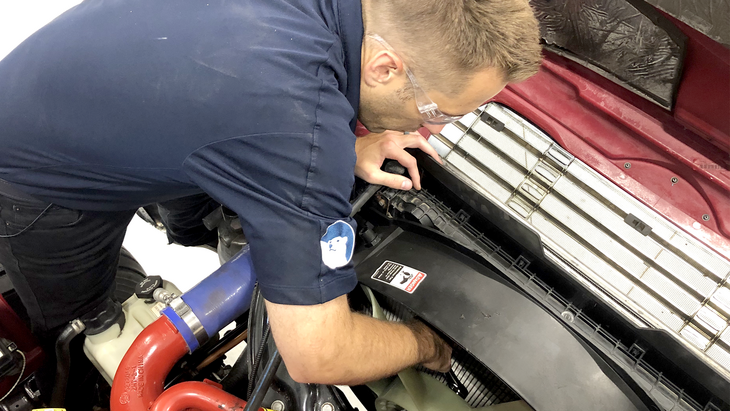 Upgrade engine cooling system Freightliner M2 mechanic working on truck