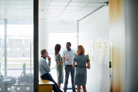 Company employees interact to help determine a solution