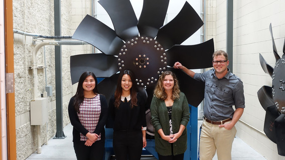 Interns standing in front of a fan at Horton