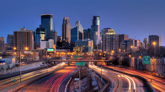 Downtown Minneapolis skyline lit up at night